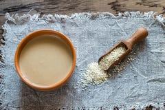 Bowl of tahini with sesame seeds Stock Image