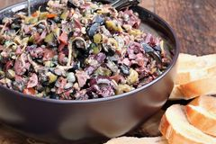 Bowl of Tapenade on Toasted Bread. Homemade mixed Olive Tapenade made with garlic, capers, olive oil, Kalamata, black and green olives with toasted bread stock images
