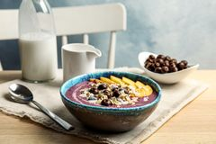 Bowl with tasty acai smoothie on wooden table stock photos