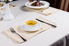 Bowl of tasty autumn pumpkin soup Royalty Free Stock Photo