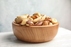 Bowl with tasty Brazil nuts on white table. Closeup royalty free stock photos