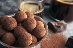 Bowl of tasty chocolate truffles on table. Closeup with space for text stock image