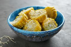 Bowl with tasty corn cobs. On table Royalty Free Stock Photo