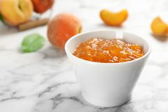 Bowl with tasty peach jam stock photo