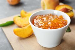 Bowl with tasty peach jam royalty free stock image