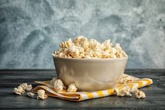 Bowl of tasty popcorn on   table. Bowl of tasty popcorn on wooden table Stock Photography