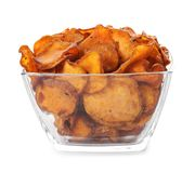 Bowl of tasty sweet potato chips isolated. On white royalty free stock images