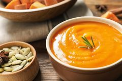 Bowl of tasty sweet potato soup on table. Bowl of tasty sweet potato soup served on table royalty free stock images