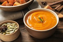 Bowl of tasty sweet potato soup. Served on table stock photography