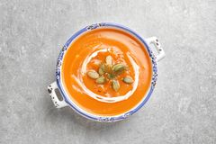 Bowl of tasty sweet potato soup on table. Top view stock images