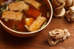 Bowl of tasty traditional japanese miso soup with fried tofu pie Royalty Free Stock Photo