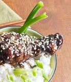 Bowl of teriyaki and sesame chicken on white rice Stock Photos