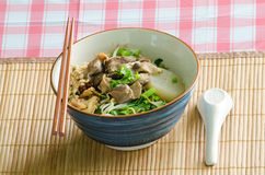A bowl of Thai style beef noodle with spoon and chopstick. Stock Image