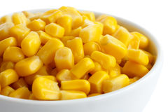 Bowl of tinned sweetcorn isolated on white. Detail. Royalty Free Stock Images
