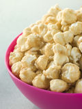 Bowl Of Toffee Popcorn. Close Up Of A Bowl Of Toffee Popcorn Stock Photography