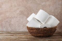 Bowl with toilet paper rolls on wooden table. Space for text stock images