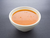 Bowl of tomato bisque with shrimp Stock Photo