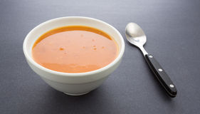 Bowl of tomato bisque soup with spoon Royalty Free Stock Photos