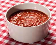 Bowl of tomato puree on a rustic table stock photos