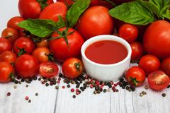 Bowl with tomato sauce stock image