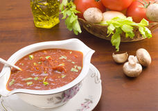 Bowl of tomato sauce with herbs Royalty Free Stock Images