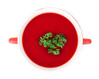 Bowl of tomato soup with basil. Stock Image