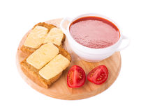 Bowl of tomato soup on board. Stock Images