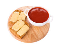 Bowl of tomato soup on board. Royalty Free Stock Photography