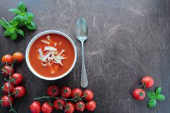 Bowl with tomato soup on wooden board Royalty Free Stock Images
