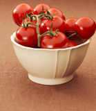 Bowl with tomatoes Stock Photo
