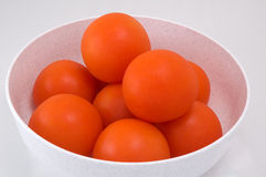 Bowl of tomatoes. A bowl of fresh tomatoes on white background Royalty Free Stock Photos