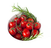Bowl with tomatoes and rosemarie. On white royalty free stock photos