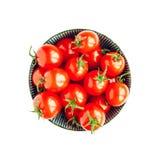 Bowl of tomatoes on white background Stock Photos