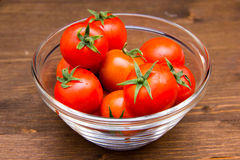 Bowl of tomatoes on wood Stock Photography