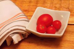 Bowl with tomatos Stock Photos