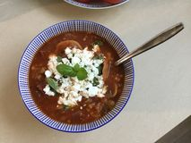 Bowl of soup. Bowl with tomatosoup goatcheese and basel Stock Photos