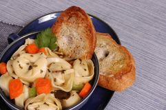 Bowl of Tortellini with crostini. Warming bowl of cheese tortellini soup with crostini Stock Photo