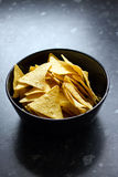 Bowl of tortilla chips. On a black kitchen counter Royalty Free Stock Photography
