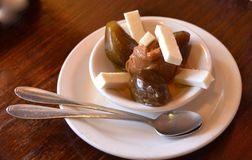 Colombian Dessert. A bowl of traditional Colombian braves con arequipe or stewed figs with dulce de leche or sweet condensed milk, and fresh cheese Stock Photography