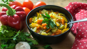 A bowl of traditional italian minestrone soup with ingredients Royalty Free Stock Photography
