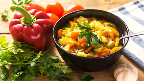 A bowl of traditional italian minestrone soup with ingredients Stock Photography