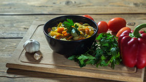 A bowl of traditional italian minestrone soup with ingredients Royalty Free Stock Photos