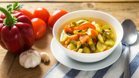 A bowl of traditional italian minestrone soup with ingredients Stock Image