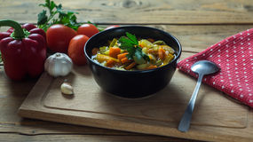 A bowl of traditional italian minestrone soup with ingredients Stock Photo