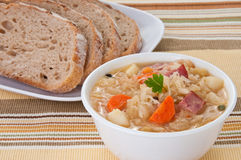 Bowl of traditional Polish sauerkraut soup Stock Photos