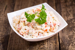 Bowl of traditional russian salad Stock Images