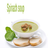 Bowl of traditional spinach soup with crouton, isolated on white Stock Photo