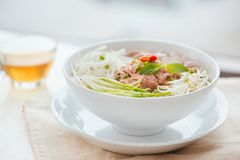 A bowl of traditional Vietnamese Pho noodle Stock Photos