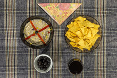 Bowl of tuna salad, tortilla chips, olives and glass of red wine Royalty Free Stock Photography