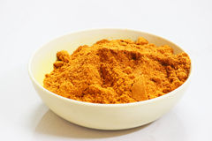 Bowl of turmeric powder, Indian spices stock image
